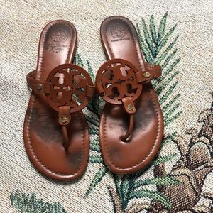 Torn burch leather flats